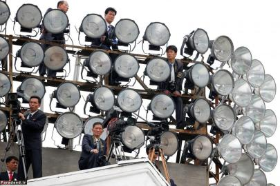 Cameramen take position atop one of buildings in the capital's main ceremonial square during a mass rally and parade. REUTERS/Damir Sagolj