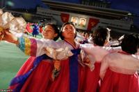 People participate in a mass dance. REUTERS/Damir Sagolj